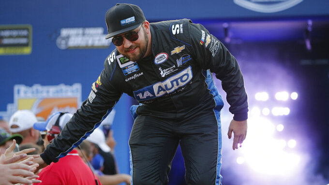 Spencer Boyd greets fans during driver introductions for the NASCAR Monster Energy Cup series auto race at Richmond Raceway in Richmond, Va., Saturday, Sept. 21, 2019. (AP Photo/Steve Helber)