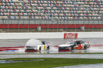 Brandon Brown (68) hits a puddle in front of Noah Gragson (9) during a NASCAR Xfinity Series auto race at Charlotte Motor Speedway in Concord, N.C., Saturday, Oct. 10, 2020. (AP Photo/Nell Redmond)