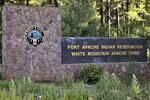 This Thursday, June 25, 2020 photo provided by C.M. Clay, shows the entrance to Fort Apache Indian Reservation in eastern Arizona. The reservation, home to the White Mountain Apache Tribe, will be under lockdown this weekend to help slow the spread of the coronavirus. (C.M. Clay/White Mountain Apache Tribe via AP)