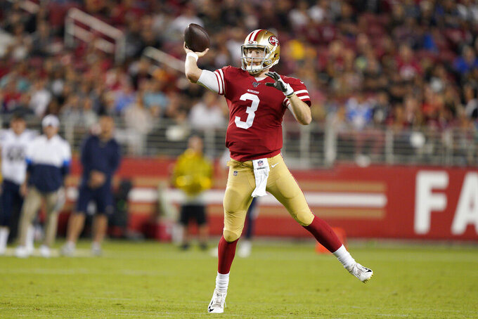 San Francisco 49ers quarterback C.J. Beathard throws a pass against the Los Angeles Chargers during the first half of an NFL preseason football game in Santa Clara, Calif., Thursday, Aug. 29, 2019. (AP Photo/Tony Avelar)