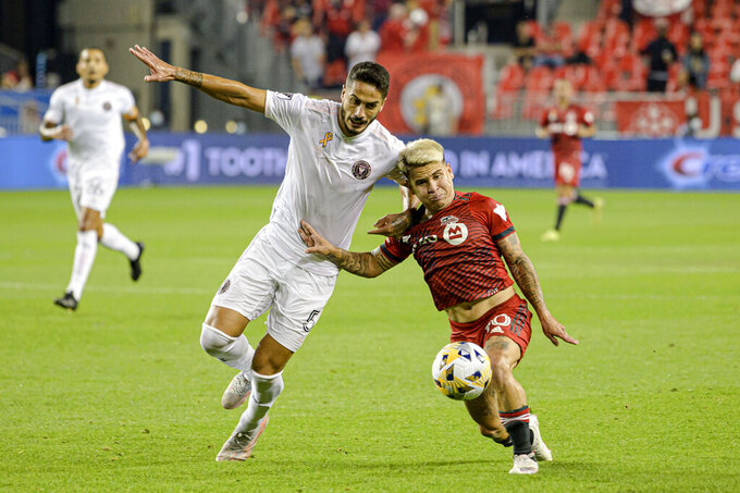 Toronto FC midfielder Yeferson Soteldo, right, and Inter Miami defender Nicolas Figal (5) vie for the ball during the first half of an MLS soccer match Tuesday, Sept. 14, 2021, in Toronto. (Christopher Katsarov/The Canadian Press via AP)