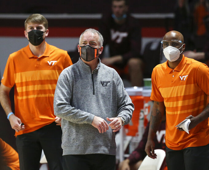 Virginia Tech head coach Mike Young looks on during the first half of an NCAA college basketball game against Penn State, Tuesday, Dec. 8, 2020 in Blacksburg Va. (Matt Gentry/The Roanoke Times via AP, Pool)