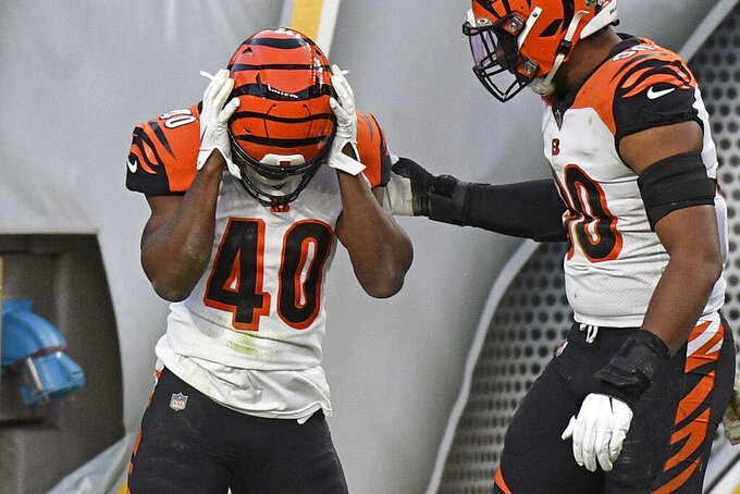 Cincinnati Bengals safety Brandon Wilson (40) holds his head after being tackled in the end zone for a touchback during the first half of an NFL football game against the Pittsburgh Steelers in Pittsburgh, Sunday, Nov. 15, 2020. (AP Photo/Don Wright)
