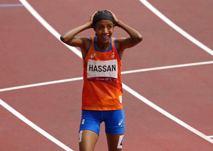 Sifan Hassan, of Netherlands reacts after winning a women's 1,500-meter heat at the 2020 Summer Olympics, Monday, Aug. 2, 2021, in Tokyo, Japan. (AP Photo/Charlie Riedel)