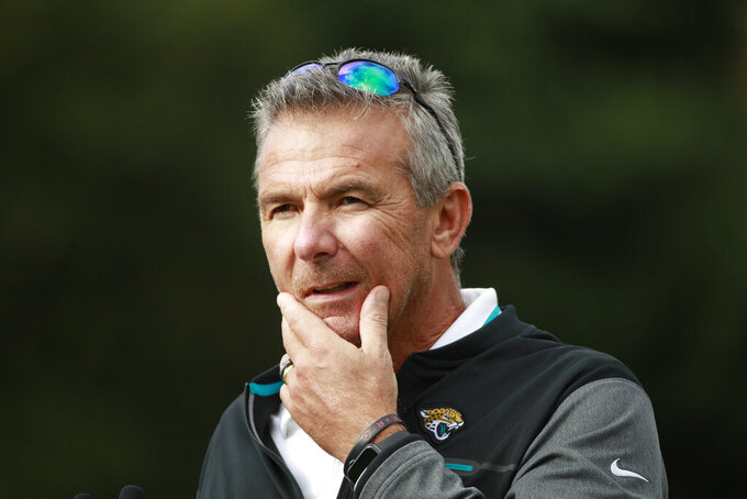 Jacksonville Jaguars head coach Urban Meyer listens to a question during a practice and media availability by the Jacksonville Jaguars at Chandlers Cross, England, Friday, Oct. 15, 2021. The Jaguars will plat the Miami Dolphins in London on Sunday. (AP Photo/Ian Walton)