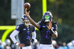 Baltimore Ravens quarterback Lamar Jackson, right, throws a pass as quarterback Kenji Bahar looks on at a joint practice hosted by the Carolina Panthers at the NFL football team's training camp in Spartanburg, S.C., Wednesday, Aug. 18, 2021. (AP Photo/Nell Redmond)