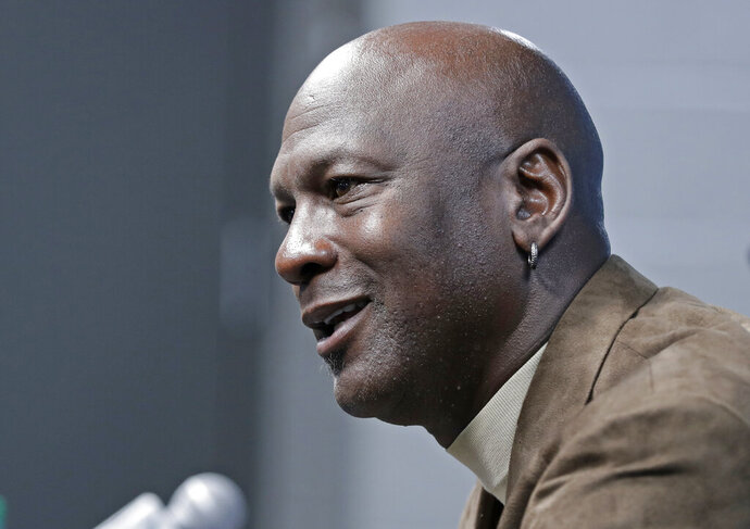 Charlotte Hornets owner Michael Jordan speaks to the media about hosting the NBA All-Star basketball game during a news conference in Charlotte, N.C., Tuesday, Feb. 12, 2019. (AP Photo/Chuck Burton)