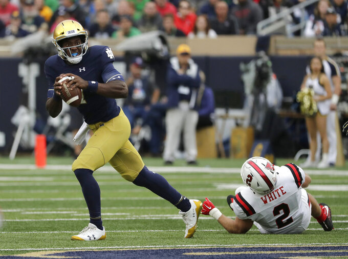 File- This Sept. 8, 2018, file photo shows Notre Dame quarterback Brandon Wimbush looking to pass against Ball State during the first half of an NCAA college football game in South Bend, Ind. Wimbush is practicing with Notre Dame to be the No. 2 quarterback for the third-ranked Fighting Irish in the Cotton Bowl amid questions about his future with the team after the College Football Playoff. There have been several media reports indicating that Wimbush has notified Notre Dame that he intends to transfer. (AP Photo/Nam Y. Huh, File)