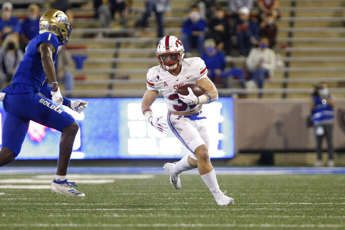 SMU running back Tyler Lavine (31) carries during the first half of the team's NCAA college football game against Tulsa in Tulsa, Okla., Saturday, Nov. 14, 2020. (AP Photo/Joey Johnson)