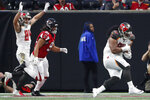 Tampa Bay Buccaneers defensive tackle Vita Vea (50) runs into the end zone for a touchdown against the Atlanta Falcons during the first half of an NFL football game, Sunday, Nov. 24, 2019, in Atlanta. (AP Photo/John Bazemore)