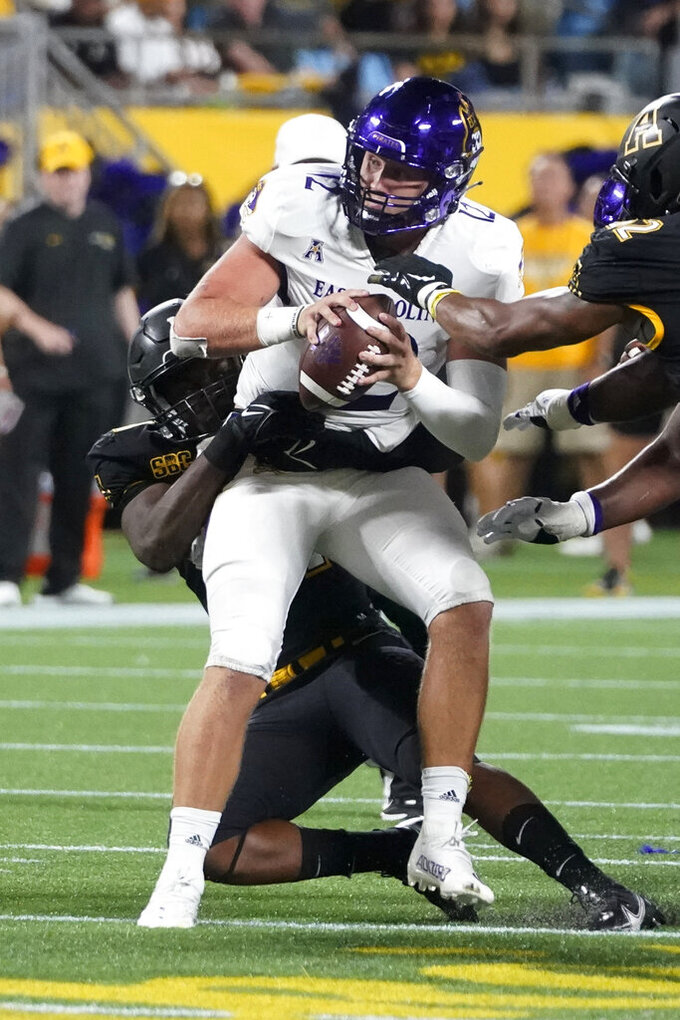 East Carolina quarterback Holton Ahlers is sacked by Appalachian State linebacker Nick Hampton during the first half of an NCAA college football game Thursday, Sept. 2, 2021, in Charlotte, N.C. (AP Photo/Chris Carlson)