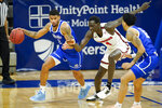 Drake forward Tremell Murphy, left, drives past Illinois State forward Abdou Ndiaye (4) during the second half of an NCAA college basketball game, Monday, Feb. 1, 2021, in Des Moines, Iowa. Drake won 95-60. (AP Photo/Charlie Neibergall)