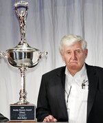 FILE - In this Dec. 4, 2008, file photo, Bob Bahre poses for photographers after being awarded the Buddy Shuman Award at the NASCAR Media Luncheon in New York. Bahre, who brought NASCAR racing to New England at the New Hampshire International Speedway, has died at his home in Maine at 93. (AP Photo/Kathy Willens, File)