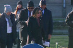 U.S. House Speaker Nancy Pelosi, centre, and a Congressional delegation during a visit to the former Nazi death camp of Auschwitz-Birkenau, Poland, Tuesday Jan. 21, 2020.  At the memorial site in southern Poland, Pelosi laid a wreath at the Auschwitz Death Wall where inmates were executed, ahead of the upcoming 75th anniversary of its liberation by Soviet troops. (TVN via AP)