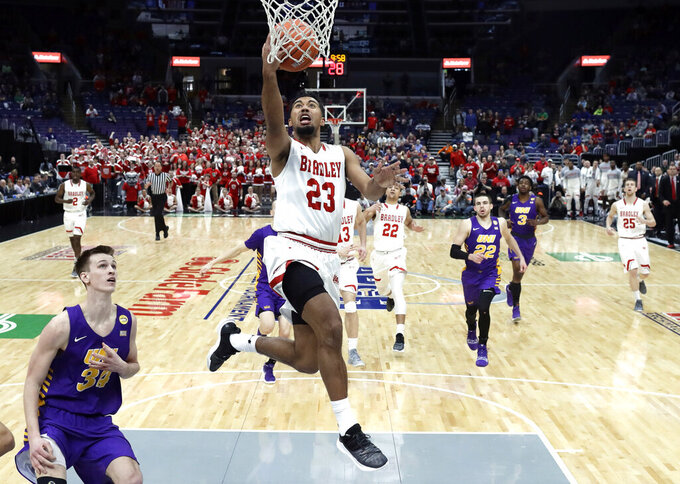 Bradley's Dwayne Lautier-Ogunleye (23) heads to the basket during the first half of an NCAA college basketball game against Northern Iowa in the championship of the Missouri Valley Conference tournament, Sunday, March 10, 2019, in St. Louis. (AP Photo/Jeff Roberson)