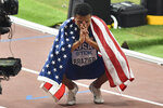 Donavan Brazier, of the U.S., celebrates winning the the men's 800 meter final at the World Athletics Championships in Doha, Qatar, Tuesday, Oct. 1, 2019. (AP Photo/Martin Meissner)