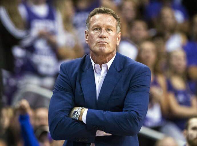 FILE - In this Dec. 9. 2018, file photo, Grand Canyon coach Dan Majerle watches his team play Nevada during the first half of an NCAA college basketball game in Phoenix. Former men's basketball coach Dan Majerle has filed a lawsuit for breach of contract after being fired by Grand Canyon in March 2020. (AP Photo/Darryl Webb, File)