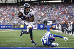 Denver Broncos' Tim Patrick (81) breaks a tackle by New York Giants' James Bradberry (24) to score a touchdown during the first half of an NFL football game Sunday, Sept. 12, 2021, in East Rutherford, N.J. (AP Photo/Adam Hunger)