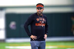 Miami coach Manny Diaz watches the NCAA college football team's practice Tuesday, Aug. 10, 2021, in Coral Gables, Fla. (AP Photo/Lynne Sladky)