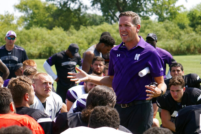 In this image provided by Northwestern University Athletics, Northwestern senior associate athletic director for health, safety and performance Tory Lindley addresses the Wildcats' football team after NCAA college football practice in Kenosha, Wis. Lindley is the president of the National Athletic Trainers Association, which has put together an app to help athletic trainers assist understaffed hospitals and health care systems during the COVID-19 pandemic. (Northwestern University Athletics via AP)