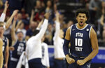 Utah State's Alphonso Anderson (10) reacts after sinking a 3-point shot during the second half of an NCAA college basketball game for the Mountain West Conference men's tournament championship Saturday, March 7, 2020, in Las Vegas. (AP Photo/Isaac Brekken)