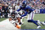 Denver Broncos tight end Albert Okwuegbunam (85) dives for a touchdown as New York Giants cornerback James Bradberry (24) attempts to stop him during the second half of an NFL football game Sunday, Sept. 12, 2021, in East Rutherford, N.J. (AP Photo/Adam Hunger)