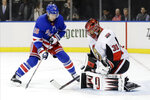Ottawa Senators goaltender Anders Nilsson (31) stops a shot on goal by New York Rangers' Ryan Strome (16) during the second period of an NHL hockey game Monday, Nov. 4, 2019, in New York. (AP Photo/Frank Franklin II)