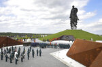 Russian President Vladimir Putin, background second right, and Belarusian President Alexander Lukashenko, right, attend an opening ceremony of the monument in honour of the World War II Red Army, in the village of Khoroshevo, just outside Rzhev, about 200 kilometers (about 125 miles) northwest of Moscow, Russia, Tuesday, June 30, 2020. (Andrei Stasevich/BelTA Pool Photo via AP)