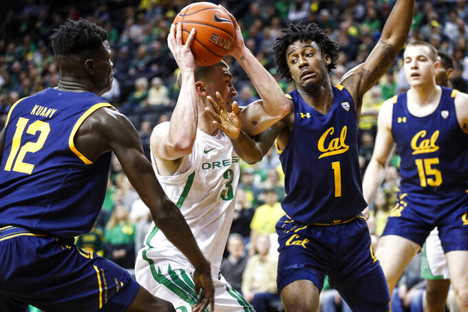 Oregon guard Payton Pritchard (3), tangles with California guard Joel Brown (1), during the first half of an NCAA college basketball game in Eugene, Ore., Thursday, March 5, 2020. (AP Photo/Thomas Boyd)