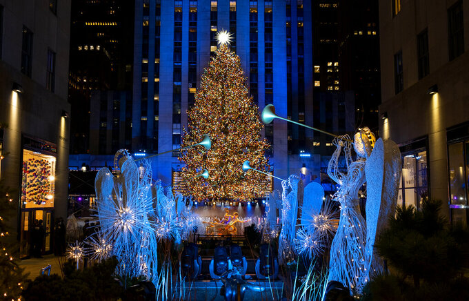 More than 50,000 lights on the 75-foot-tall Rockefeller Center Christmas Tree are illuminated at the annual Rockefeller Center Christmas Tree lighting ceremony, Wednesday, Dec. 2, 2020, in New York. The ceremony is a mask-mandated, time-limited, socially distanced event due to the coronavirus pandemic. (AP Photo/Craig Ruttle)