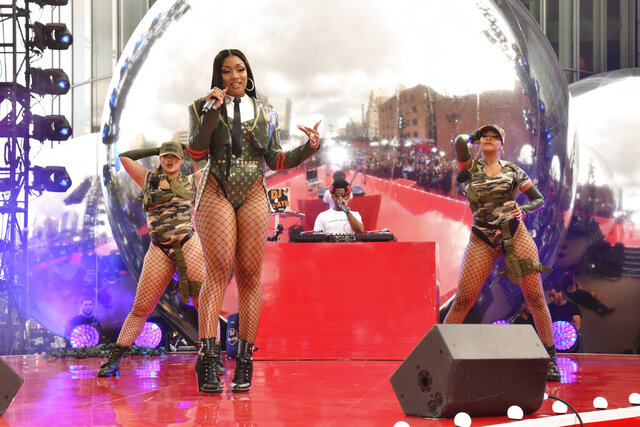 "FILE - In this Aug. 26, 2019, file photo, Megan Thee Stallion performs at the MTV Video Music Awards at the Prudential Center in Newark, N.J. The singer says she works extremely hard in the studio when it comes to writing music, so when she almost couldn't release her new album due to drama with her record label, she was anxious and uneasy. ""I was super-nervous,"" she said in an interview with The Associated Press this week after a Houston judge ordered the Friday, March 6, 2020, release of her album as her bitter court battle with her label continues. (Photo by Charles Sykes/Invision/AP, File)"