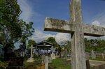 Family members gather at a funeral of Easter Sunday bomb blast victim at Methodist cemetery in Negombo, Sri Lanka, Tuesday, April 23, 2019. (AP Photo/Gemunu Amarasinghe)