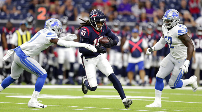 Houston Texans wide receiver DeAndre Hopkins (10) is tackled by Detroit Lions defensive back Tracy Walker (47) as outside linebacker Christian Jones (52) covers during the first half of an NFL preseason football game Saturday, Aug. 17, 2019, in Houston. (AP Photo/Michael Wyke)