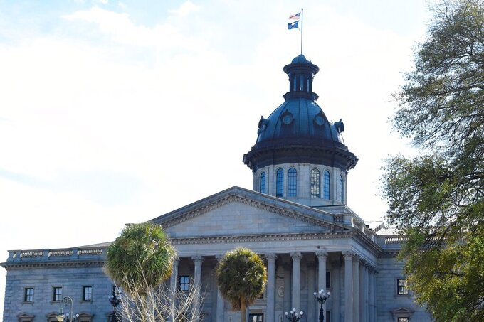 FILE - This Jan. 17, 2021, file photo shows the South Carolina Statehouse in Columbia, S.C. South Carolina's Legislature is ending its regular session on Thursday, April 13, 2021, ceremonially wrapping up its duties but expecting at least several returns later in the year to handle more work, including how to spend federal funding related to the coronavirus pandemic. (AP Photo/Meg Kinnard, File)
