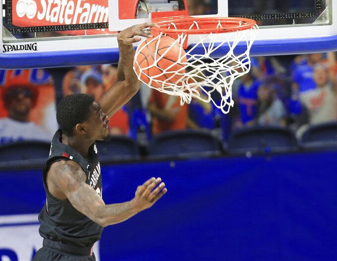 South Carolina forward Keyshawn Bryant dunks against Florida during the first half of an NCAA college basketball game Wednesday, Feb. 3, 2021, in Gainesville, Fla. (AP Photo/Matt Stamey)