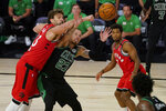 Boston Celtics' Daniel Theis (27) and Toronto Raptors' Marc Gasol (33) battle for a rebound during the second half of an NBA conference semifinal playoff basketball game Monday, Sept. 7, 2020, in Lake Buena Vista, Fla. (AP Photo/Mark J. Terrill)
