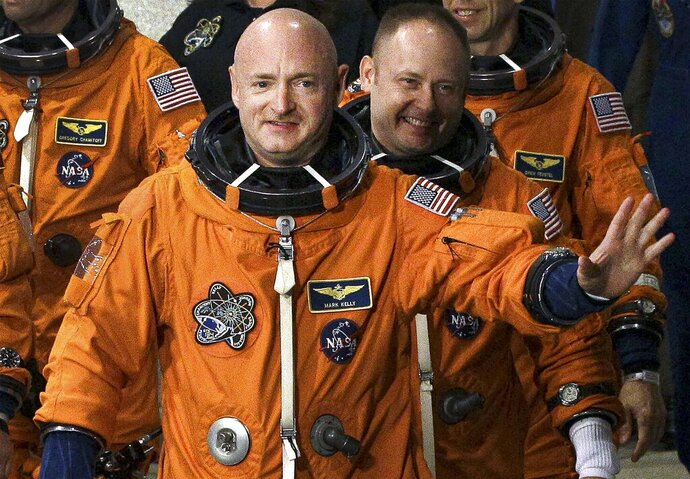 FILE - In this May 16, 2011, file photo, former NASA astronaut STS-134 commander Mark Kelly, front, waves a he leaves the Operations and Checkout Building with fellow crew members, including Mike Fincke, for a trip to Launch Pad 39-A, and a planned liftoff on the space shuttle Endeavour at Kennedy Space Center in Cape Canaveral, Fla. A Kelly victory would shrink the GOP's Senate majority at a crucial moment and complicate the path to confirmation for President Donald Trump's Supreme Court nominee. (AP Photo/Chris O'Meara, File)