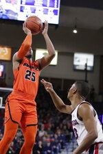 Pacific guard Kendall Small (25) shoots while defended by Gonzaga guard Zach Norvell Jr. during the first half of an NCAA college basketball game in Spokane, Wash., Thursday, Jan. 10, 2019. (AP Photo/Young Kwak)