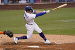 Los Angeles Dodgers' Enrique Hernandez follows through to hit a two-run scoring single during the fifth inning of a baseball game against the Houston Astros in Los Angeles, Sunday, Sept. 13, 2020. (AP Photo/Alex Gallardo)