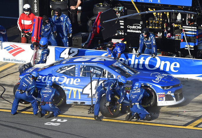 Crew members perform a pit stop on Kyle Larson's car during a NASCAR Cup Series auto race at Charlotte Motor Speedway in Concord, N.C., Sunday, May 26, 2019. (AP Photo/Mike McCarn)