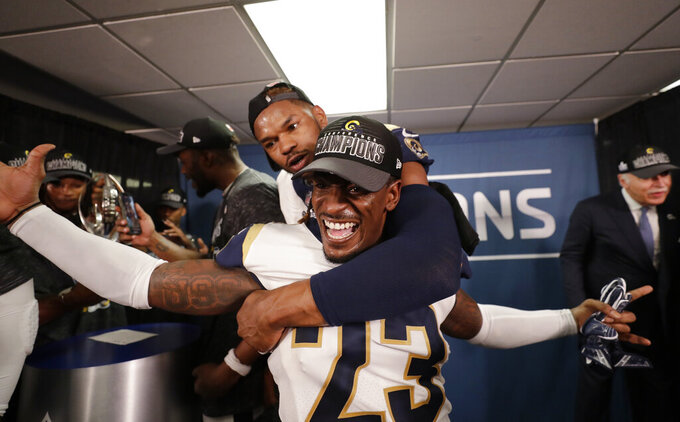Los Angeles Rams defensive back Nickell Robey-Coleman (23) celebrates in the locker room after overtime of the NFL football NFC championship game, against the New Orleans Saints, Sunday, Jan. 20, 2019, in New Orleans. The Rams won 26-23. (AP Photo/David J. Phillip)