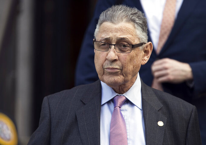 FILE - In this May 11, 2018 file photo, former New York Assembly Speaker Sheldon Silver leaves federal court in New York. Silver who was released from a federal prison on furlough, is being returned to federal prison after federal authorities denied him home confinement.  (AP Photo/Mary Altaffer, File)