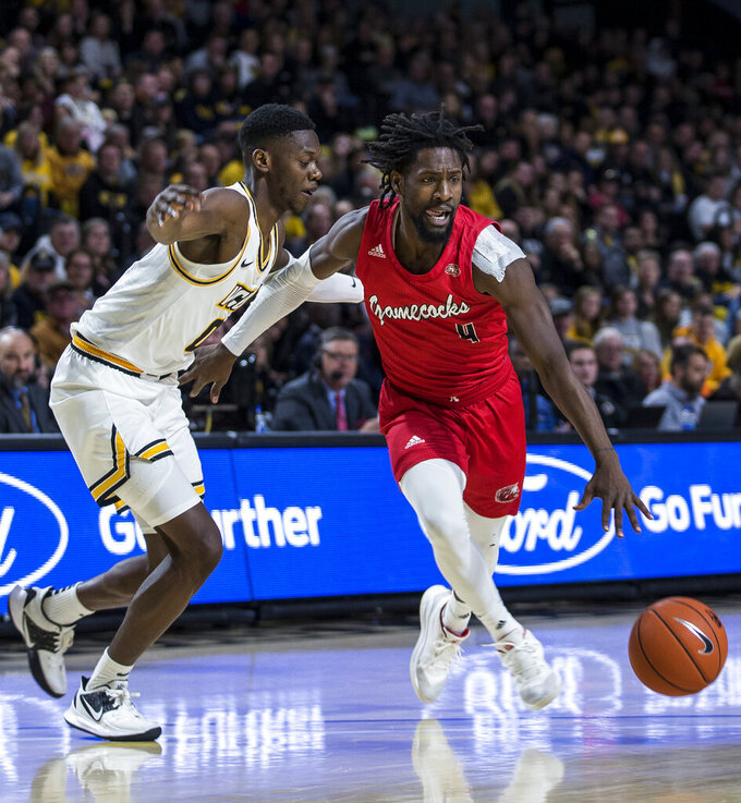 Jacksonville State point guard Ty Hudson (4) drives around Virginia Commonwealth guard De'Riante Jenkins (0) during the first half of an NCAA college basketball game Sunday, Nov. 17, 2019 in Richmond, Va. (AP Photo/Zach Gibson)