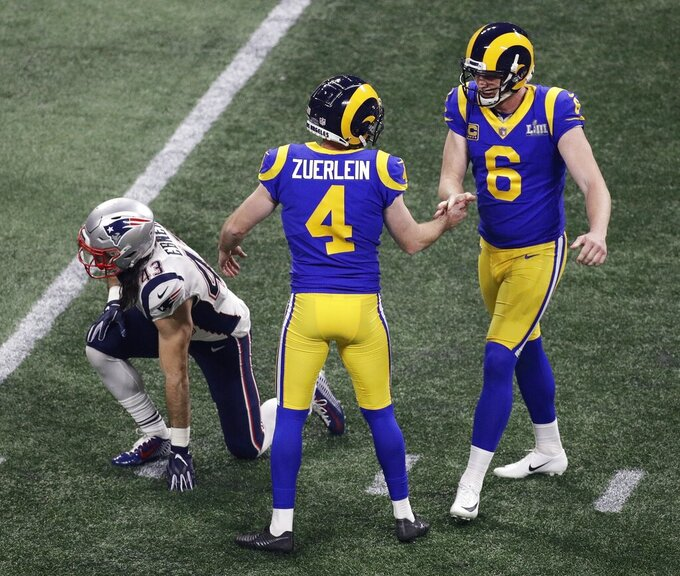 Los Angeles Rams' Greg Zuerlein (4) celebrates his 53-yard field goal with Los Angeles Rams' Johnny Hekker (6) during the second half of the NFL Super Bowl 53 football game against the New England Patriots, Sunday, Feb. 3, 2019, in Atlanta. (AP Photo/Charlie Riedel)