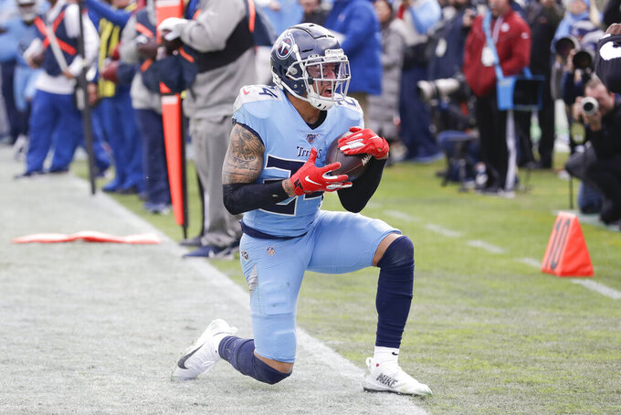 Tennessee Titans strong safety Kenny Vaccaro gets up after intercepting a pass against the Houston Texans in the first half of an NFL football game Sunday, Dec. 15, 2019, in Nashville, Tenn. (AP Photo/James Kenney)