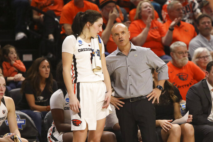 Oregon State head coach Scott Rueck, right, talks with Aleah Goodman (1) during the second half of a first-round game of the NCAA women's college basketball tournament against Boise State in Corvallis, Ore., Saturday, March 23, 2019. (AP Photo/Amanda Loman)