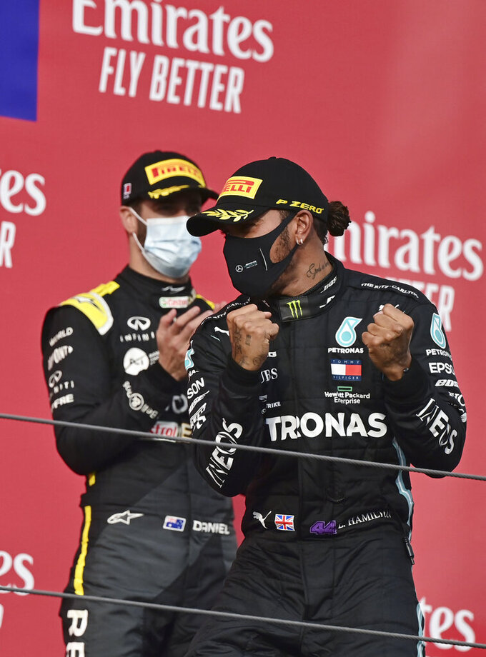 Mercedes driver Lewis Hamilton of Britain, right, celebrates on the podium after winning the Emilia Romagna Formula One Grand Prix, at the Enzo and Dino Ferrari racetrack, in Imola, Italy, Sunday, Nov.1, 2020. (Miguel Medina, Pool via AP)