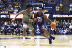 TCU guard RJ Nembhard (22) is defended by West Virginia guard Miles McBride during the first half of an NCAA college basketball game Tuesday, Jan. 14, 2020, in Morgantown, W.Va. (AP Photo/Kathleen Batten)