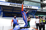 Scott Dixon, of New Zealand, celebrates with is wife, Emma Davies-Dixon, after winning the pole for the Indianapolis 500 auto race at Indianapolis Motor Speedway, Sunday, May 23, 2021, in Indianapolis. (AP Photo/Darron Cummings)