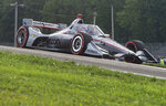 Will Power, of Australia, exits a turn during the IndyCar Series auto race at Mid-Ohio Sports Car Course, Saturday, Sept. 12, 2020, in Lexington, Ohio. (AP Photo/Phil Long)